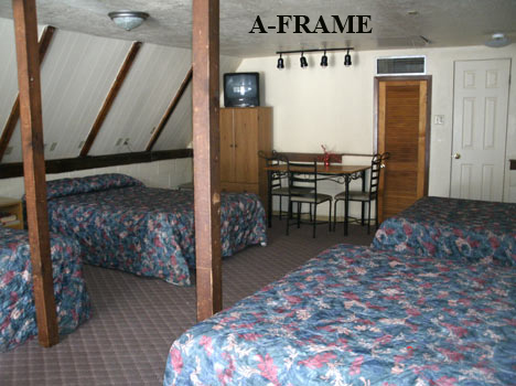 "Alta Vista Chalet Motel's ""A-FRAME"" has four queen size beds.  A large comfortable room with a private bath.  Come on and experience a great visit to Cloudcroft.  575-682-2221"
